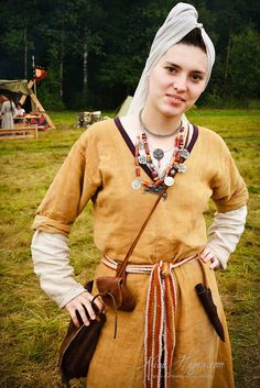 A reenactor at the Gorodets Living History Festival 2006 shows off ancient Slavic pagan garb, pouches, amulets, and jewelry. 2006/ Gorodetskoe Gulbishe 2006