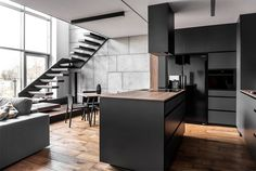Masculine apartment in Poland has an open kitchen area - Home Decorating Trends - Homedit Zeitgenössisches Apartment, Apartment Renovation, Apartment Interior Design, Kitchen Interior, Interior Livingroom, Apartment Kitchen, Bathroom Interior, Apartment Ideas, Masculine Apartment