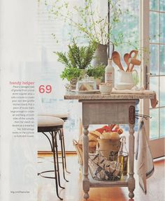 Top a console table with granite to make a slim-profile island - Add a vintage hook to hang kitchen towels and give the piece an antique feel - from Better Homes and Gardens 100 Ideas Flea Market Style - Photo by John Bessler