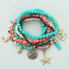 Beaded charm bracelets designed by Denise Yezbak Moore
