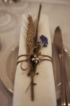 Wheat and forget-me-not napkin decor / http://www.deerpearlflowers.com/wheat-wedding-decor-ideas/