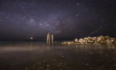 """Astrophotographer Jennifer Khordi sent in a photo of the night sky seen from the beach in Ocean City, New Jersey. She writes in a email message to Space.com: """"I was photographing the rising Milky Way [on Feb. 16, 2015], which was the first time the Milky Way rose before the moon and pre-dawn twilight this Milky Way viewing season. A large, bright green meteor lit up the sky traveling very fast towards the horizon while I was taking this image. The bright object over the ocean was the…"""