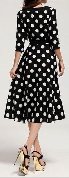 Polka Dot. Really cute. I love polka dots. I also like the length of the dress as well