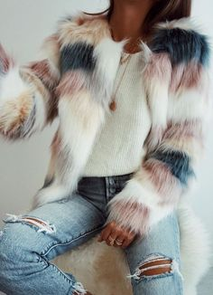 Love the colors in this striped faux-fur coat.