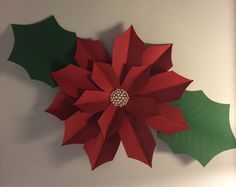 A personal favorite from my Etsy shop https://www.etsy.com/listing/555661357/poinsettia-paper-flower-template