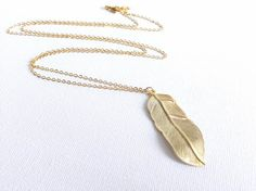 Love this. gold feather necklace  long feather necklace  by cbijicollection, $20.00
