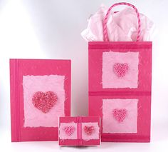 Valentine's Day cards and gifts accented with beads formed into a heart.