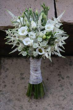 white lisianthus, fluffy white astilbe, spiky white veronica, scented white freesias and astrantia.