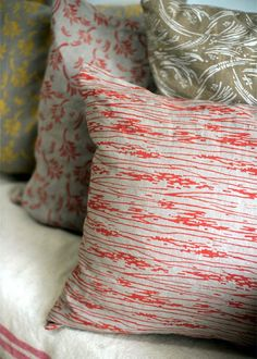 Grab a paint roller and some paint to DIY these pillows.