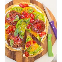 Over my birthday weekend I whipped up this incredibly simple heirloom tomato tart in my silver kitchen.  Its all about the crust and let me just say that it is to die for -- it's infused with Vodka which creates a crispy electrifying crunch when baked and the combination of ricotta and cream cheese blended together with salt and pepper with the sweet tomatoes ---- ahhhh.  This is an excellent way to enjoy the sweetness of late summer heirloom tomatoes.  Recipe link in profile