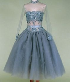 1950's beaded blue/gray cocktail party dress, with illusion bodice trimmed in silver embroidered lace and grey beads, short full eighteen-layer tulle skirt, and back buttons. No maker label.
