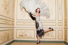1920s Flapper Dresses go best with feathers.