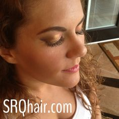 Smokey gold airbrush makeup and false eyelashes