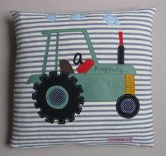 £ 50.00    Appliqued personalised tractor cushion   Cotton fabric   Real feather pad   Size 36 cm x 36 cm   Made to order, please specify a name if wanted and tractor colour Sophie Harding west Penzance