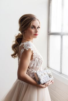 Silver laces and rhinestone details make this a gorgeous bespoke couture bridal clutch.