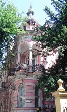 Here's a full view of that lovely balcony; Bratislava, Slovakia: pink house with decorative iron railings on Stefanikova.