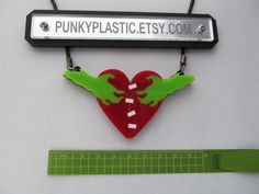 Laser cut zombie heart necklace by punkyplastic on Etsy