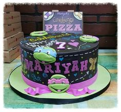 We love this purple-accented Ninja Turtle cake. Perfect for a girl's Teenage Mutant Ninja Turtle birthday party.