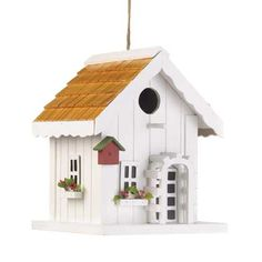 Happy Home Birdhouse Bright and cheery, just like the song of the lucky bird that gets to call this sweet house home! A perfect complement to your yard, this charming birdhouse features tiny window boxes bursting with tiny faux flowers, a trellis around the front door, and even a tiny little birdhouse of its own on the corner. Hang this from a tree in your yard and watch as new neighbors flock to move in!