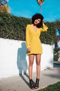 This bright yellow dress makes me happy. It's like sunshine in an outfit.