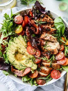Rosemary Chicken, Bacon & Avocado Salad -- Creamy avocado, crispy bacon, chicken that is to.die.for, lots of spring greens and butter lettuce, some sweet cherry tomatoes, watercress and a rosemary vinaigrette!