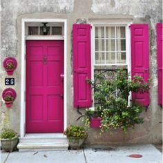 Hot pink door and shutters If any color pink would ever go on my house it would definitely be this one.
