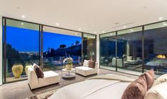 Walls of glass provide the bed with an uninterrupted view of the sparkling city lights.