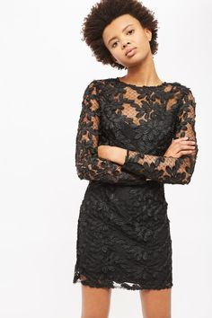 The lace dress always gets it right, and this style in chic black is no different. Equipped with long sleeves, it features stunning leaf applique detail.