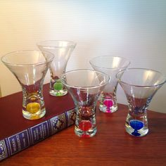 Five short martini glasses filled with solid liquid color bubbles by FromTheSeller on Etsy