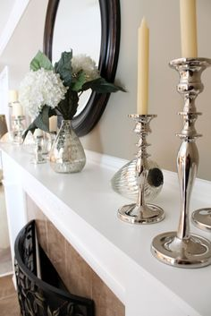 Love the round mirror and silver touches. Modern and classic together