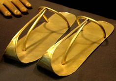Slippers and false finger which are funerary items from the tomb of King Sheshonq II. Cairo Museum, Egypt.