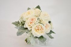Modern white bridal bouquet  Garden roses, baby's breath and dusty Miller leaves www.plushflowers.ca