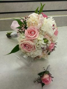 Pink and White Prom Bouquet and matching Pink Boutonniere. White Hydrangea, Pale pink peony, eucalyptus, pink German statice, pink roses