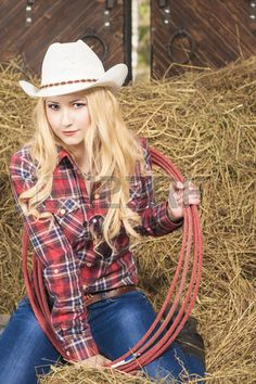 Passionate Caucasian Cowgirl With Lasso Rope in Farm. Vertical Image
