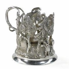 A silver sculptural tea-glass holder, maker's mark IN in Cyrillic, St. Petersburg, 1873