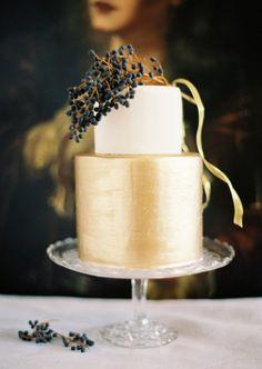 Elegant gold wedding cake with black berries -  Photo by Jose Villa via Style Me Pretty