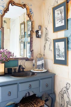 sketches-turned-wallpaper in the bathroom