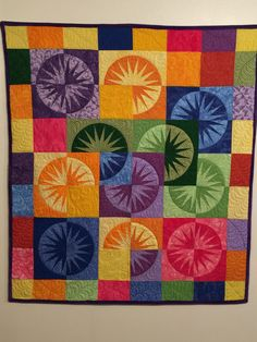 Desert Sky by Quiltworx. Made with bright primary colors. I added bright purple cuddle/minkie as the backing