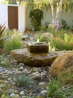 Inspiring Small Front Yard Landscaping Ideas with Rock Fountain on a Budget Landscaping With Rocks, Backyard Landscaping, Wisconsin Landscaping Ideas, Dry Riverbed Landscaping, Landscaping With Fountains, Florida Landscaping, Modern Landscaping, Rock Fountain, Fountain Ideas