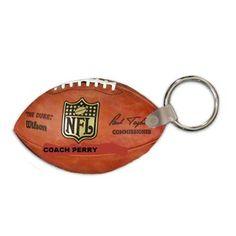 "$5.00 Key Tag, Football Shaped, with Split Metal Key Ring and Plastic Snap, 2 Sided Gloss Fiberglass Reinforced Plastic, 1.875"" x 3"" x .090"" Thick."