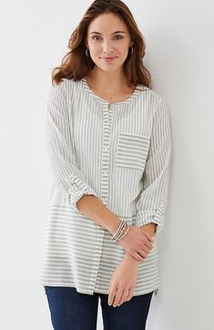 "striped button-front cotton tunic style no.W6039V Button-front tunic with vertical stripes above the waist and horizontal stripes below and on the front pocket. Round neckline. Long sleeves roll and tab to 3/4 length. Trocas shell buttons. Side vents. Slightly longer in back. Thigh length. Thigh length: M 30½"", P 28½"", W 32"", T 32½"" Long sleeves Front closure 100% cotton woven Machine wash, tumble dry, low"
