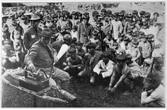 Kalingas listening to a speech by one of their chiefs via a dictaphone (1914)