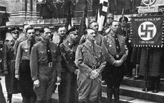 """Hitler, Hess and Himmler and others stand in front of the """"Feldherrnhalle,"""" the War Memorial on the Odeonsplatz, during a ceremony commemorating the eleventh anniversary of the """"Beer Hall Putsch"""" on November 9, 1934. In 1923, Hitler made an abortive attempt to stage a coup d'etat in Germany. Year after year, Hitler met with the Nazi Alt-Kampfer, the Old Guard, to commemorate the memories of the martyrs. Hitler turned his trial for treason into a public relations triumph by accepting complete…"""