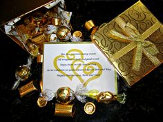 50th Golden Anniversary favor that I made. Filled a gold box with Golden wrapped candy. Rolos, Hershey Almond Nuggets, Lindt White Chocolate Truffles, and Werthers. And made a card with a special poem to go with it!