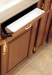 Rev-a-shelf: hardware to create a tip-out storage tray under kitchen sink