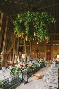 Lush Chandeliers - Create an enchanting, whimsical atmosphere with cascading greens overhead. {Lauren Fair Photography}