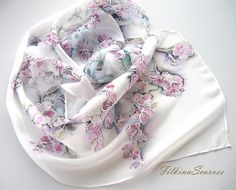 Painted Scarf,Woman silk chiffon scarf,flower scarf,white pink purple Scarf,Batik Scarf,Silk Painting,Gift for Her,Long Scarf  Gentle and elegant floral long natural silk chiffon scarf with blooming in early spring multitude of airy magenta and pale pink flowers dance along branches of the tree just as the leaves start to emerge. White background.  The fabric on which I have painted is 100% natural Silk Chiffon. The silk chiffon is very pleasant to the touch with delicate silk shine and is…