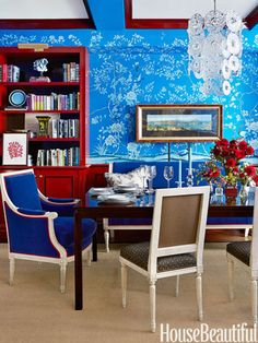 Absolutely beautiful dining room designed by Christopher Maya. Gorgeous de Gournay hand painted cobalt blue Earlham wallpaper! Ben Moore's Heritage Red on woodwork.
