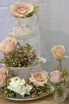 Vintage crate wedding decor vintage cup & saucer wedding flowers soft blush roses and vintage style blooms perfect for nude colour weddings and natural wedding ideas rustic charm