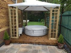 This square Wooden Pergola features a distinctive canvas.plastic roof available from Tuin